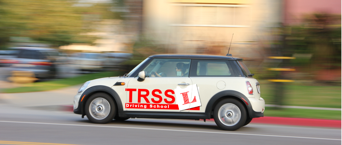 The Road Safety Solutions - TRSSL - Driving Lessons driving school car with school logo photo